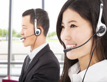 Businessman with call center agent Stock Photo