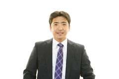 Smiling Asian businessman Royalty Free Stock Photography