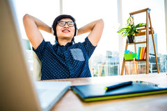 Smiling asian businessman listening to music Stock Image