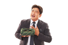 Smiling Asian businessman stock images
