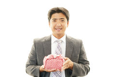 Smiling Asian businessman with a lunch box Royalty Free Stock Photos