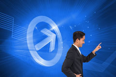 Smiling asian businessman pointing Stock Photography