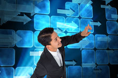 Smiling asian businessman pointing Royalty Free Stock Images