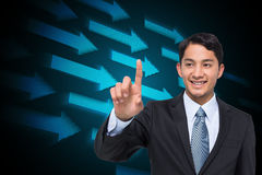 Smiling asian businessman pointing Stock Photo