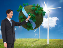 Smiling asian businessman pointing Stock Images