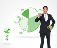Smiling asian businessman pointing Royalty Free Stock Image