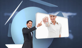 Smiling asian businessman pointing Royalty Free Stock Photo