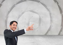 Smiling asian businessman pointing Stock Photos