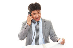 Smiling Asian businessman stock photography