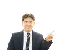 Smiling Asian businessman Stock Photo