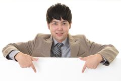 Smiling Asian businessman. With a whiteboard royalty free stock photography