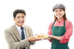 Smiling Asian businessman and a waitress Royalty Free Stock Photo