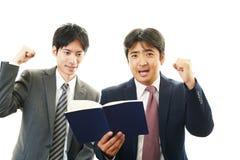 Smiling Asian businessmen Stock Photos