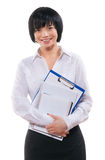 A smiling asian businesswoman holding notes in crossed arms Royalty Free Stock Images