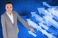 Smiling asian businesswoman pointing Royalty Free Stock Image