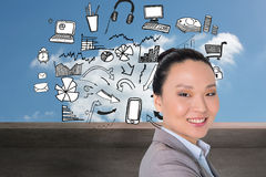 Smiling asian businesswoman pointing Royalty Free Stock Photo