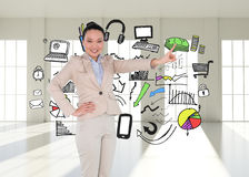 Smiling asian businesswoman pointing Royalty Free Stock Photos
