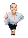 Smiling asian businesswoman showing thumbs up Royalty Free Stock Photo
