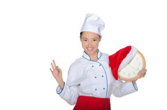 Smiling asian chef with clock and Christmas hat Royalty Free Stock Photos