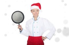 Smiling asian chef with frying pan and Christmas hat Royalty Free Stock Photo