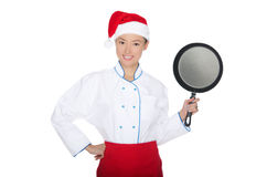 Smiling asian chef with frying pan and Christmas hat Stock Image