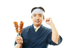 Smiling Asian chef Stock Image