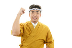 Smiling Asian chef Royalty Free Stock Images