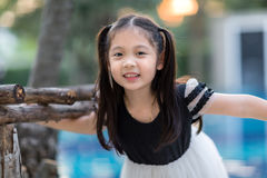 Smiling Asian Child. Asian child smiling at outdoor swimming pool Stock Image
