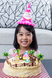 Smiling Asian Chinese little girl with celebrating birthday Royalty Free Stock Images