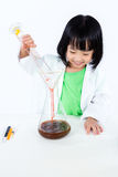 Smiling Asian Chinese Little Girl Examining Test Tube With Unifo Stock Photography
