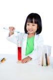 Smiling Asian Chinese Little Girl Examining Test Tube With Unifo Stock Image