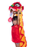 Smiling Asian Chinese little girl with Lion Dance costume. Celebrating Chinese New Year in isolated white background Royalty Free Stock Photo
