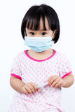 Smiling Asian Chinese Little Girl Wearing Protection Mask Stock Photo