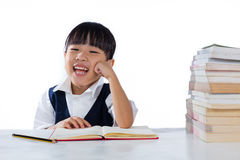 Smiling Asian Chinese little girl wearing school uniform studyin Royalty Free Stock Image