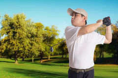 Smiling Asian Chinese Man Swinging Golf Club Royalty Free Stock Photos