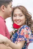 Smiling asian couple together on nature Stock Photo