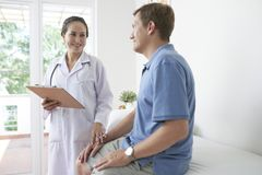 Doctor talking to patient royalty free stock images