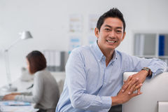 Smiling Asian entrepreneur Stock Photo