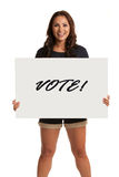 Smiling Asian Female Holding a Vote Sign Isolated Stock Images
