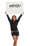 Smiling Asian Female Holding a Vote Sign Isolated Royalty Free Stock Photography