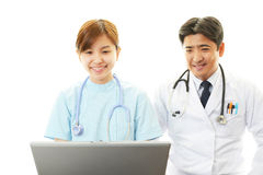 Smiling Asian female nurse and a doctor Royalty Free Stock Photos