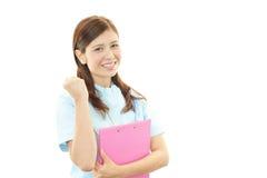 Smiling Asian female nurse. Isolated on white background Royalty Free Stock Photography