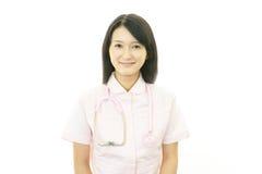 Smiling Asian female nurse. Portrait of  Asian female nurse Royalty Free Stock Photo