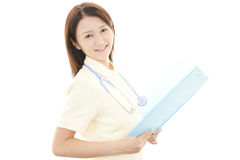 Smiling Asian female nurse. Portrait of an Asian female nurse Royalty Free Stock Images
