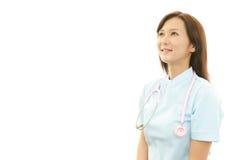 Smiling Asian female nurse Stock Photos