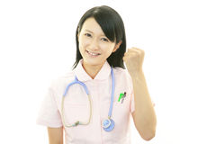 Smiling Asian female nurse. Portrait of an Asian female nurse Stock Photos