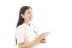 Smiling Asian female nurse. Portrait of an Asian female nurse Stock Photo