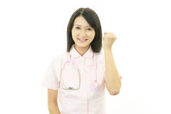 Smiling Asian female nurse. Portrait of an Asian female nurse Stock Photography