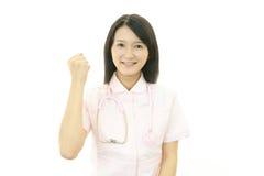Smiling Asian female nurse Stock Photo