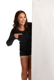 Smiling Asian Female Pointing to a Blank Board Royalty Free Stock Photography